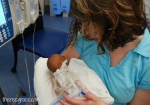 Aunt Nanc holding little Zoe in the NICU.